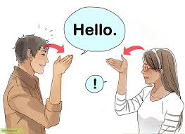 A man and woman talking in sign language