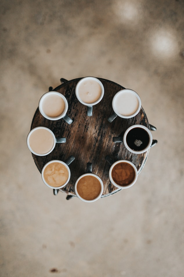 Coffees lined up with different strengths from very strong to light